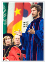 Blake Mycoskie on stage speaking to an audience