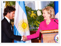Blake Mycoskie and Hillary Clinton shaking hands at the Clinton Global Initiative University plenary session